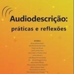 Capa do livro com fundo laranja, título e autores em letras pretas e símbolo de som com três linhas circulares acima da letra A da palavra Audiodescrição.